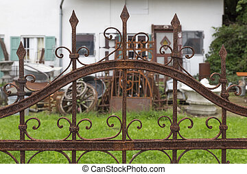 Rusted wrought iron fence