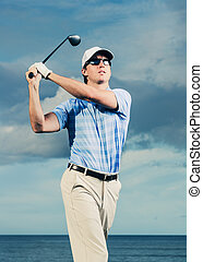Golfer swinging golf club - Golfer at sunset, Man swinging...