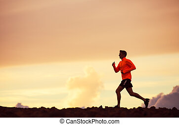 Male runner silhouette, running into sunset - Male runner...