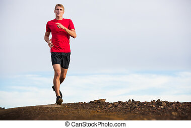 Athletic man running jogging outside, training