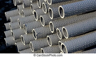Neatly stacked Large plastic pipes roadworks - A great...