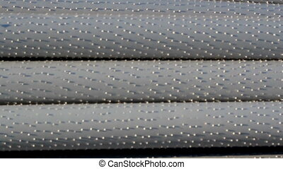An up-close image of  steel pipes piled