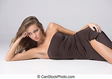 Gorgeous woman Beautiful young fashion model lying on side...