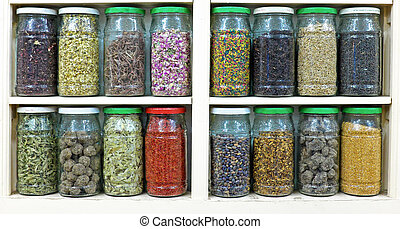 assortment of glass jars on shelves in herbalist shop in...