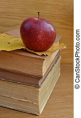 Red apple on old books