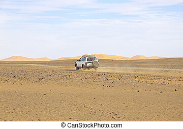 Car driving in the Erg Chebbi desert in Morocco Africa