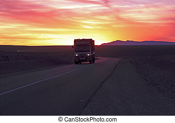 Driving through the Sahara Desert in Maroc at sunset