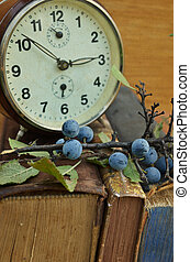 Vintage books and old clock