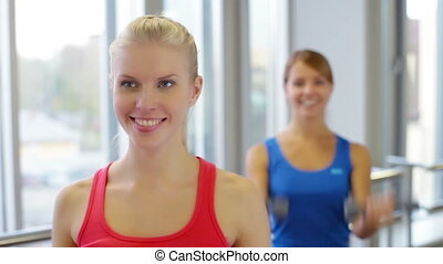 Dumbbell Training - Close-up of cheerful girls doing...