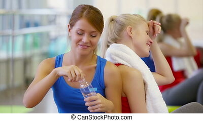 Sharing Water - Girls being tired after workout sharing...