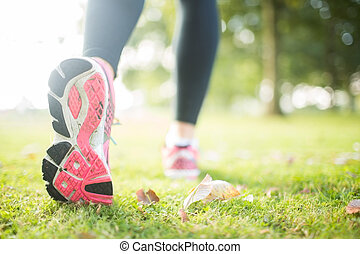 Close up picture of pink sole from running shoe in a park on...