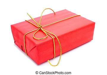 gift - a gift wrapped with red wrapping paper and with a...