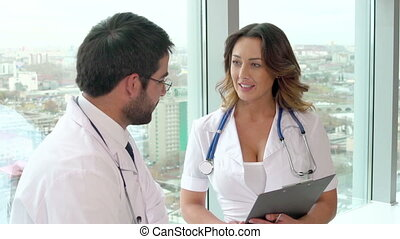 Promising Medical Case - Positive medical workers discussing...