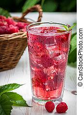 Juice of fresh raspberries with ice