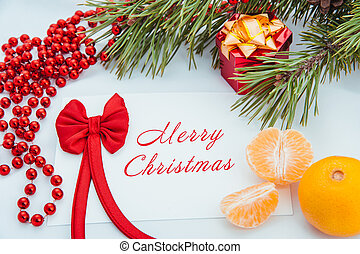 Merry Christmas - Christmas greeting card with a branch of...