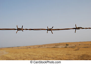 Old barbed wire - Fragment of old barbed wire on boundless...