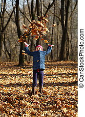 One little girl in autumn forest