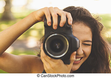 Beautiful brunette woman taking a picture