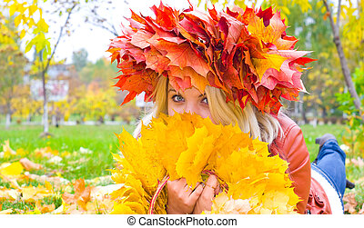 Young girl relaxing in autumn park