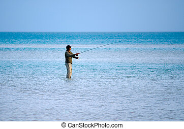 Casting for bonefish in Aitutaki Lagoon Cook Islands -...