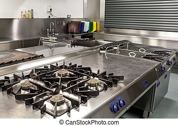 Picture of professional kitchen showing gas stove in...