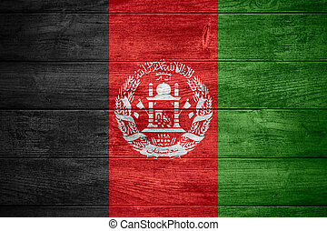 flag of  Afghanistan or Afghan banner on wooden background