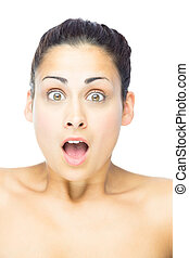 Front view of astonished woman looking at camera