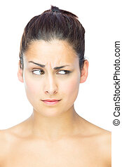 Front view of beautiful sceptical woman looking away