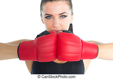 Gorgeous sporty woman posing wearing boxing gloves looking...