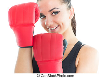 Attractive sporty woman smiling at camera wearing boxing...