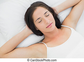 Beautiful woman sleeping in bed with eyes closed - High...