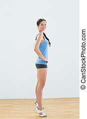 Side view of a sporty woman tip toeing - Side view portrait...