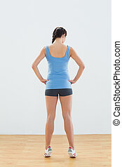 Rear view of a slim woman tip toeing - Full length rear view...