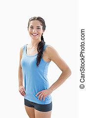 Portrait of a slim smiling woman in sportswear - Portrait of...