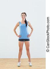 Full length of a woman tip toeing - Full length portrait of...