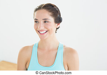 Smiling young woman in blue sports bra