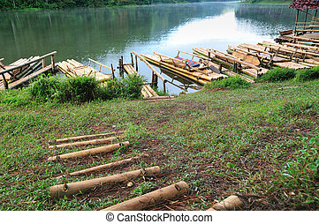 Waterfront of Reservoir with handmade bamboo raft