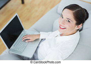 Smiling well dressed young woman us - High angle view of a...