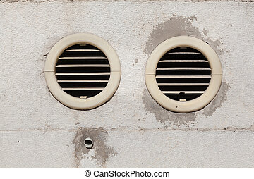 Air vents fixed on an outside wall - Two circular air...