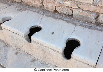 Communal Roman toilets Ephesus Turkey - Ancient roman...