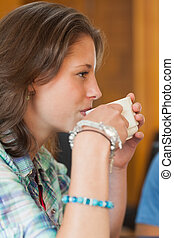 Pretty student drinking a cup of coffee