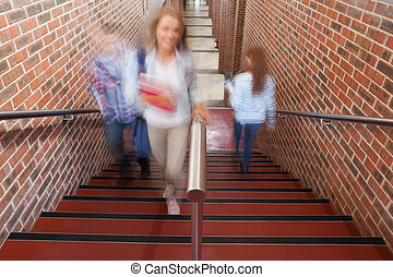 Students climbing stairs in school
