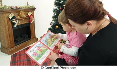 Christmas story - Mother reading a Christmas tale to her...