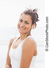 Pretty smiling woman listening to music - Beautiful smiling...