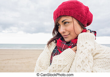 Woman in knitted hat and pullover o - Close up of a young...