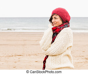 Cute woman in stylish warm clothing - Side view of a cute...