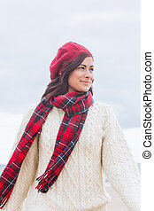 Pretty woman in stylish warm clothing looking away - Pretty...