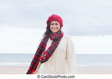 Pretty woman in stylish warm wear at beach - Portrait of a...