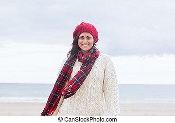 Pretty woman in stylish warm wear at beach - Portrait of a...