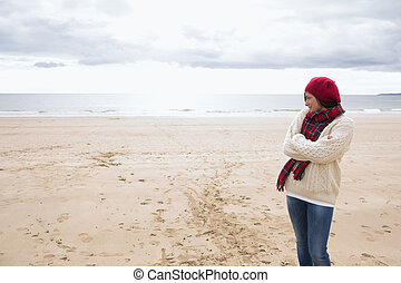 Pretty woman in stylish warm clothing at beach - Pretty...